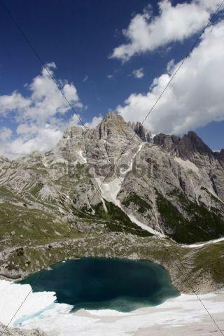 Sexten Dolomites with mountain lake and snow, Dolomite Alps, Italy, Europe