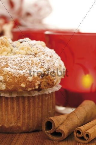 Christmas muffin and cinnamon sticks in Christmasy atmosphere