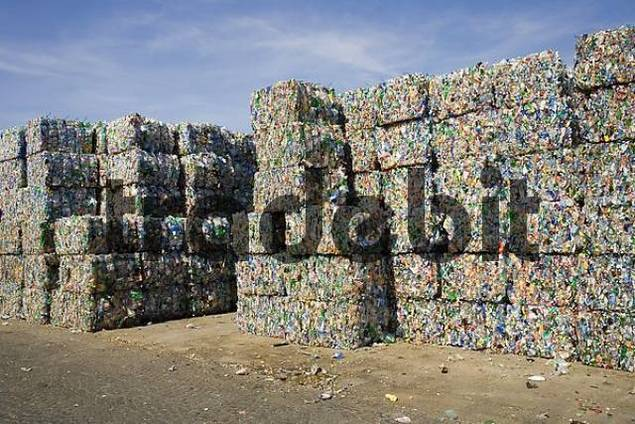 plastic bottles, sorted, compressed into bales and ready for recycling