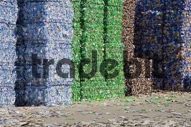plastic bottles, sorted by colour, compressed into bales and ready for recycling