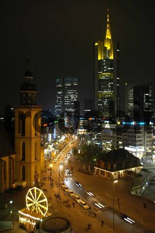 Frankfurt at night view from above on the center square of Hauptwache with illuminated sky scraper of Commerzbank Frankfurt am Main Germany