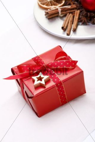 Christmas present next to a plate with Christmas decorations