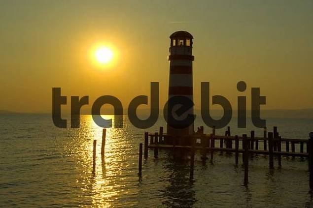 Sundown behind the light tower of Podersdorf at Neusiedler See Burgenland Austria