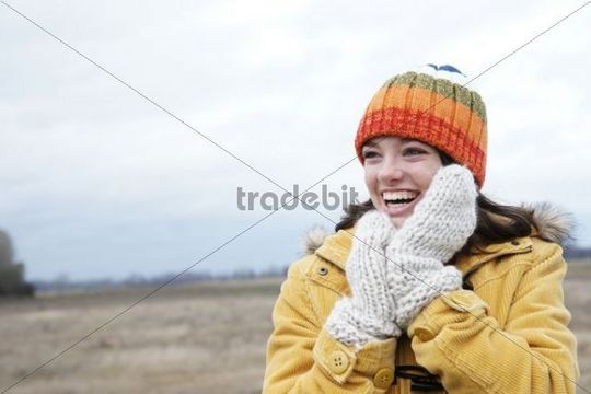 Laughing girl wearing a hat and a scarf