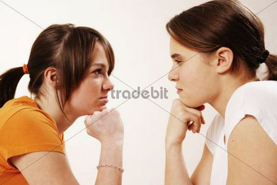 Two female teenagers arguing
