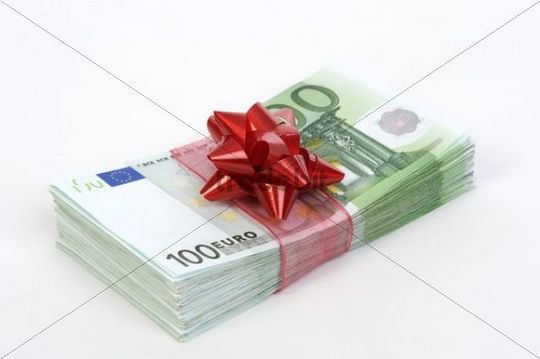 Wad of 100 Euro banknotes with red bow, symbolic of money gift