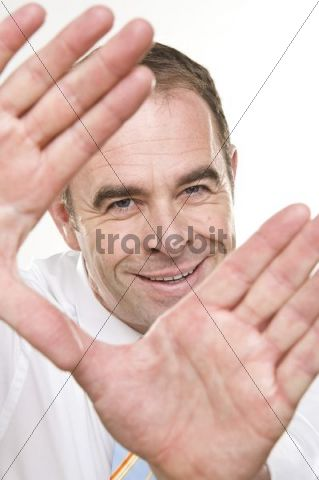 Smiling businessman forming a frame with both hands
