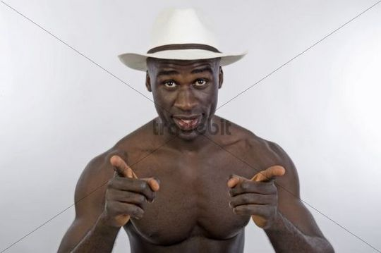 Dark-skinned man, 30, wearing a hat