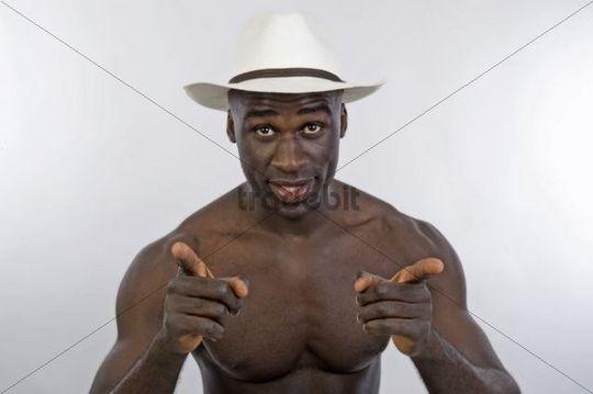 Dark-skinned man, 30, wearing a hat