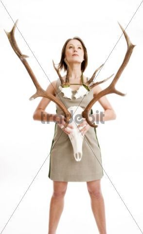 Young woman wearing traditional dress with deer antlers