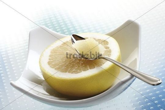 Grapefruit with a spoon