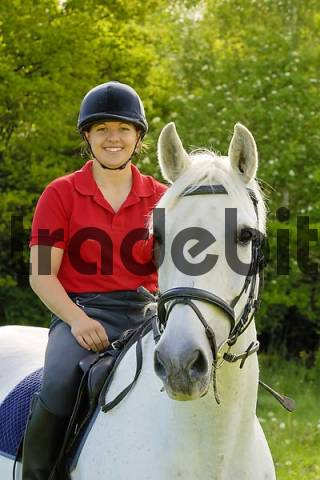 Young lady rider on a 24 years old German horse