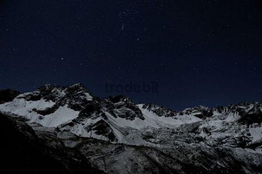 Starry sky with snow-covered Alpine peaks, Gramais, Lechtal, Reutte, Tirol, Austria, Europe