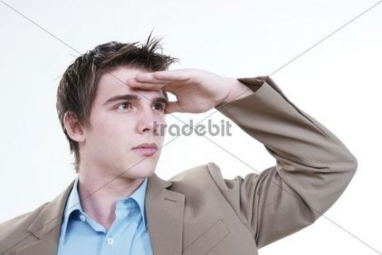 Young businessman holding his hand to his forehead ...