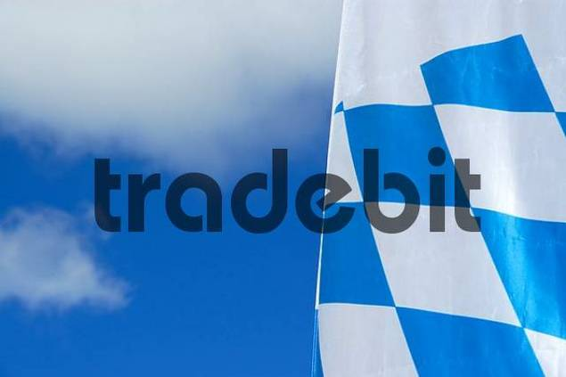 White and blue Bavarian flag wafts in the sky Bavaria Germany
