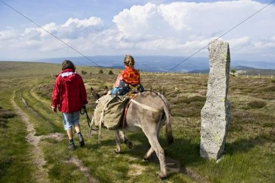 Mother and daughter on a donkey hike, Cevennes, Mont Lozere, France, Europe