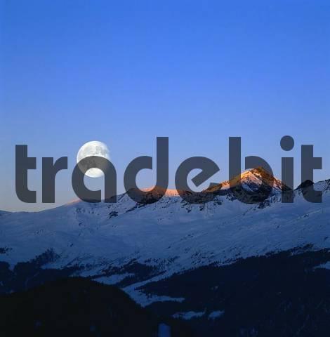 Alps peaks and full moon, Nauders, Tyrol, Austria