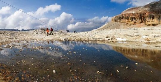 Hikers at a melt water lake on the Piz Boe peak on the Sella massif, Passo Sella, province of Bolzano-Bozen, Italy, Europe