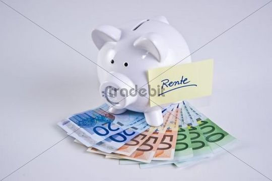 Piggy bank on bank notes, quotRentequot, pension written on a piece of paper