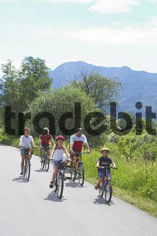 by Kochel at the lake south of Munich Bavaria Germany familiy with children on a bicycle tour