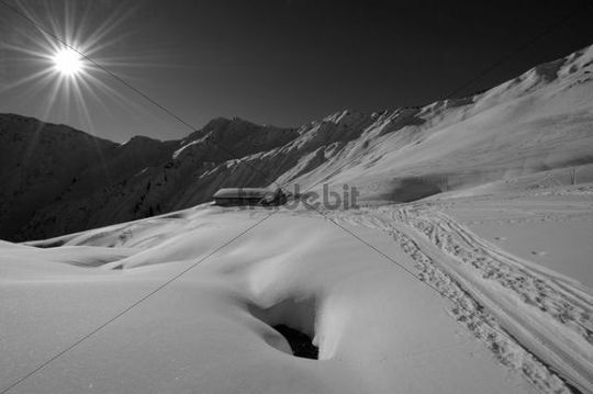 Skiing trail and alpine hut in snow-covered mountains, Mt Gruenhorn, Kleinwalsertal Valley, Austria, Europe