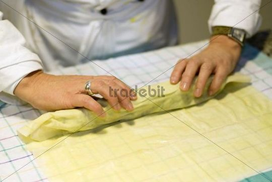 Cooking course, making a savoy cabbage strudel, forming the strudel, Germany, Europe