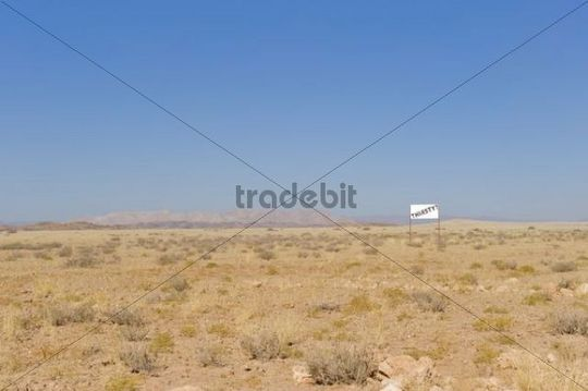 Billboard, Thirsty, at the roadside of a sandy road leading to Solitaire, Namibia, Africa