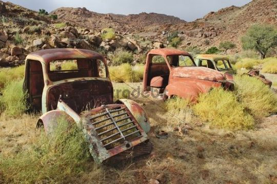 Scrap vehicles near the Namtib Lodge in the Tiras mountains, Namibia, Africa