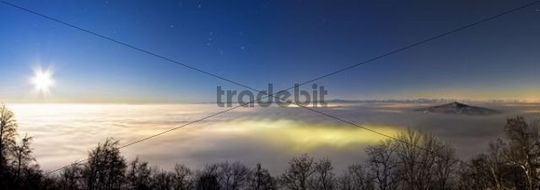 Mt Hohenstaffel at full moon, towering out of a sea of clouds, in the back the Swiss Alps, Constance County, Baden-Wuerttemberg, Germany, Europe