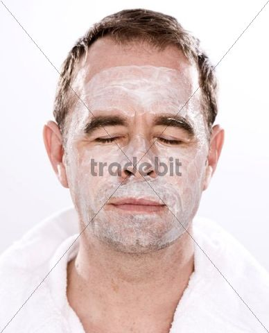 Man, lotion on his face