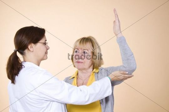 Doctor doing gymnastic exercises with a patient