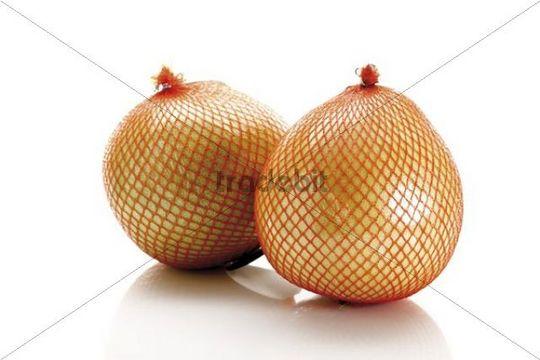 Two Honey Pomelos in a net