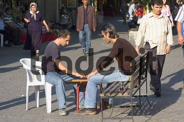 Turkey Kusadasi southern agean coast men playing backgammon