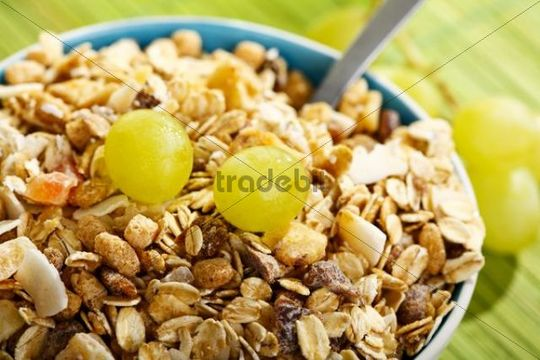 Fruit musli and grapes in a bowl