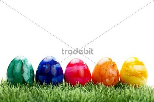 Colourful Easter eggs on a lawn