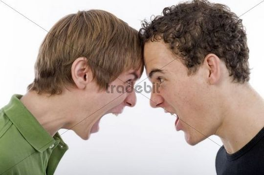 Two young men screaming each other