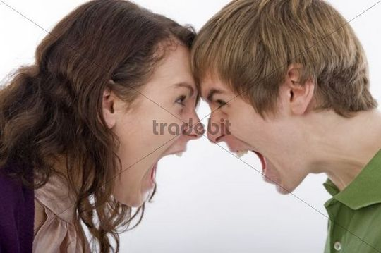Young man and young woman screaming at each other