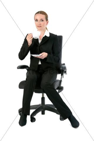 Woman Sitting On An Office Chair Drinking Coffee