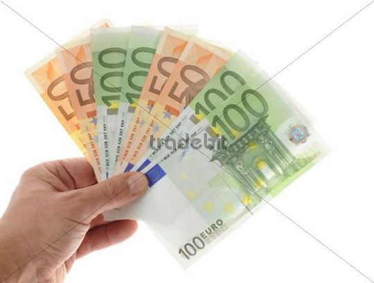 Hand holding a fan of banknotes