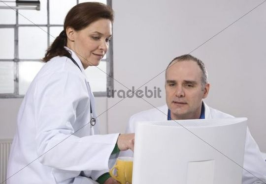 Two doctors sitting at a computer