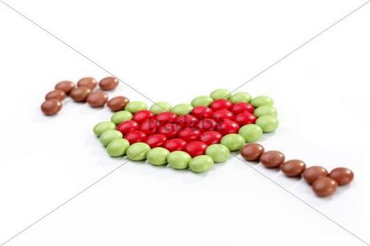 Heart shape made of coloured chocolate drops