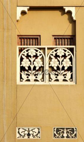 Ornamental carved window decoration on a traditional house in the Al Bastakiya region of the historic town centre of Bur Dubai, Dubai, United Arab Emirates
