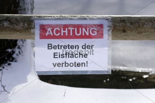 Sign on an ice hole, Achtung Betreten der Eisflaeche verboten, German for Warning, keep off the ice