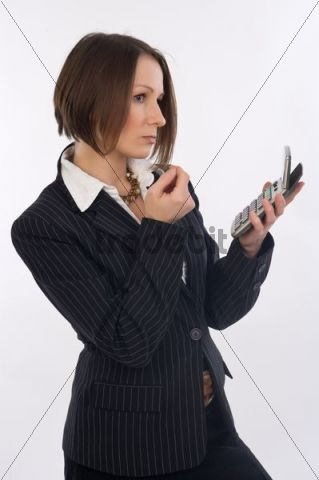 Business woman, 30, with pocket calculator