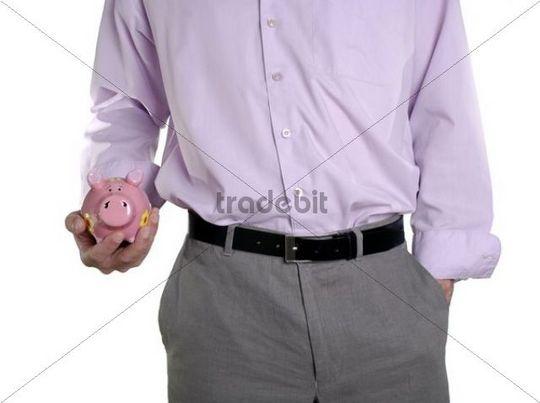 Man cradling piggy bank in his hand, conceptual shot