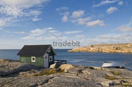 Green wooden house on the sea, Smoegen, Bohuslaaen, Sweden