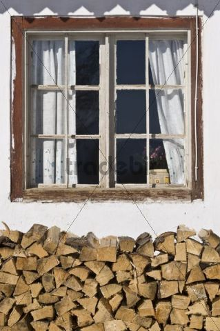 Window with pile of wood, Achenkirch, Tyrol, Austria