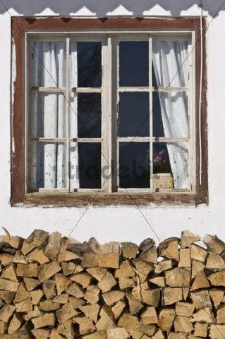 Window with pile of wood, Achenkirch, Tyrol, Austria