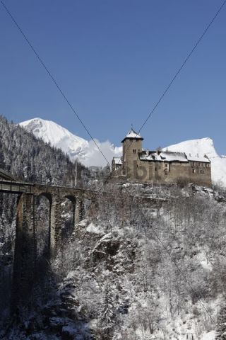 Schloss Wiesberg Castle with bridge over the Trisanna river, Paznautal Valley, Paznaun, Tyrol, Austria
