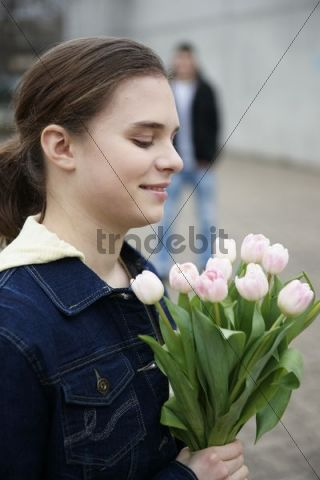 Girl holding a tulip bouquet